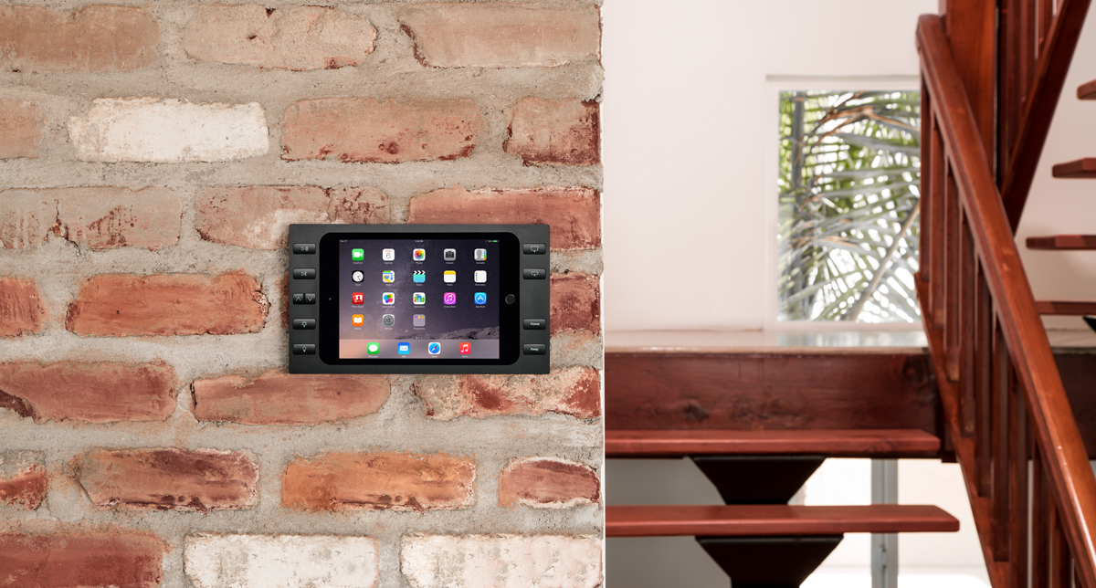 Black iPad wall mount with power and buttons in a house.