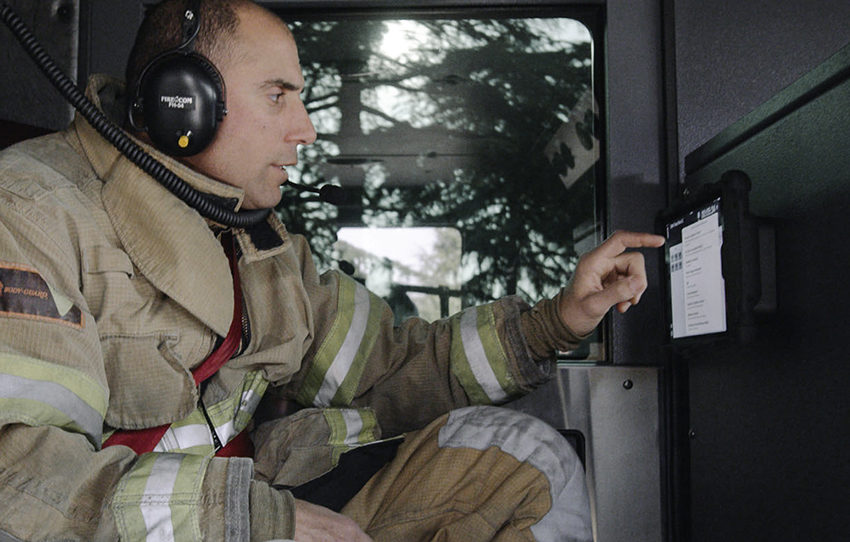 Rugged iPad case by IPORT installed on fire truck interior for use in vehicle.