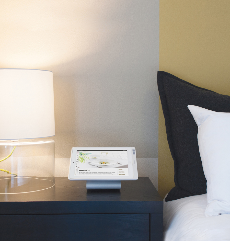 IPORT LAUNCH, the iPad charging case for hotels, running Incentient software in a hotel room.