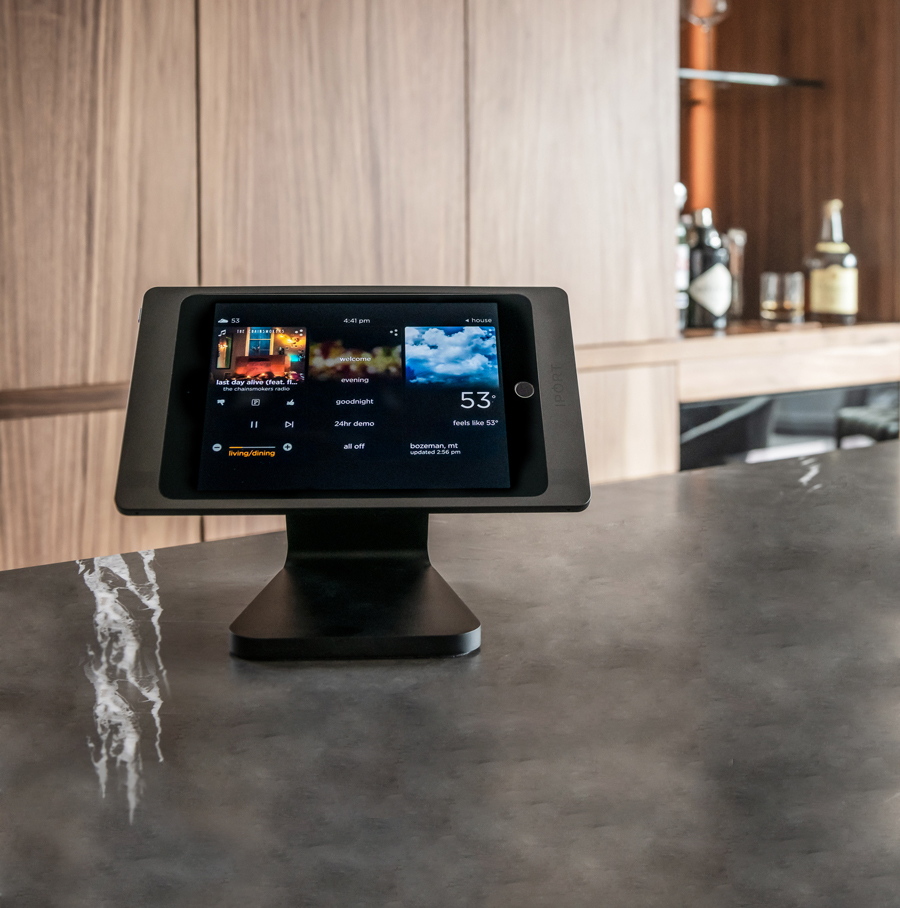 Black iPad case and mount by IPORT used for home automation in a kitchen.