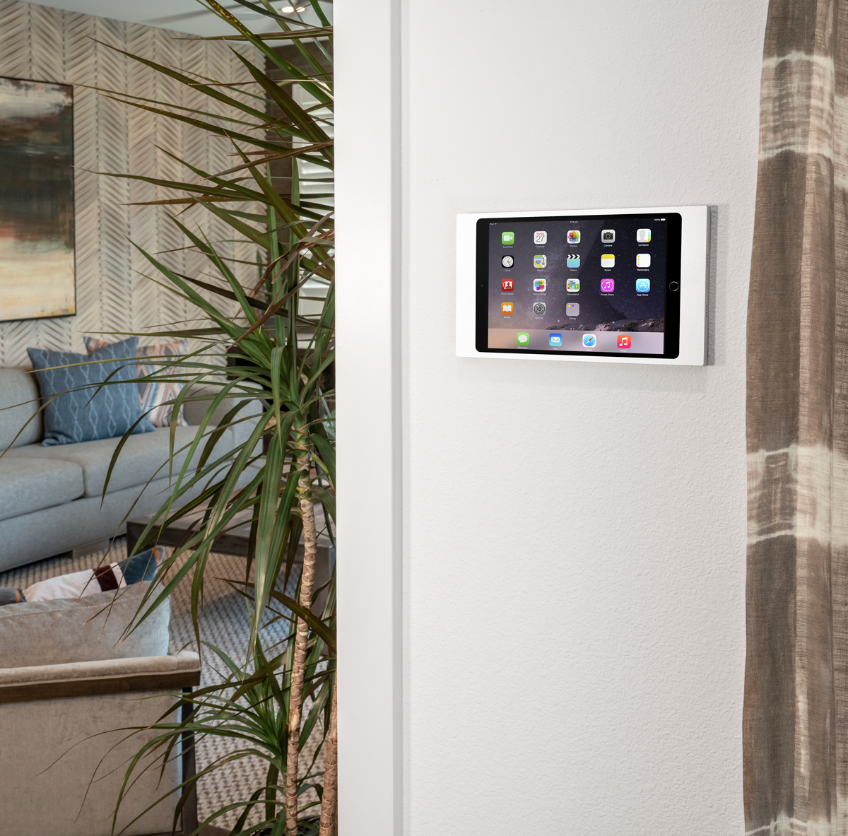 Surface Mount, the silver iPad wall mount by IPORT installed in a home.