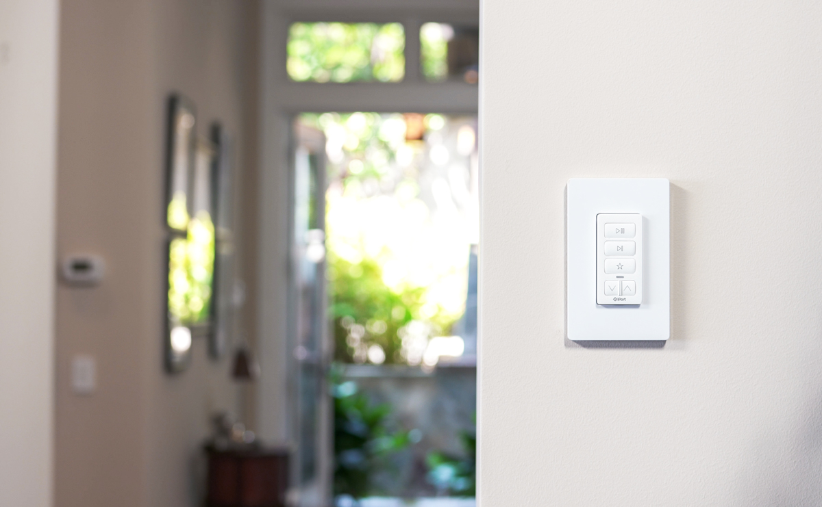 Remote for Sonos by IPORT mounted on a wall.